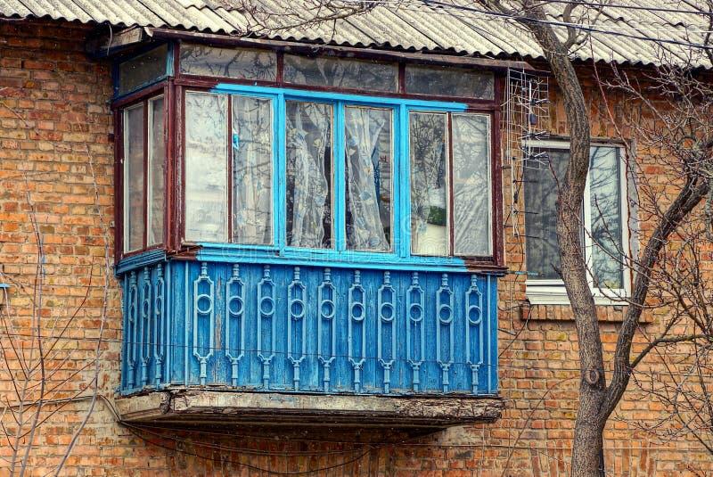 Old balcony in multi-storey residential brick house stock photo