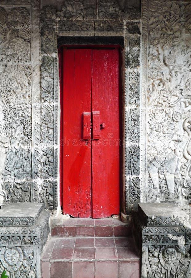 Old balinese wood door, Sanur, Bali royalty free stock images