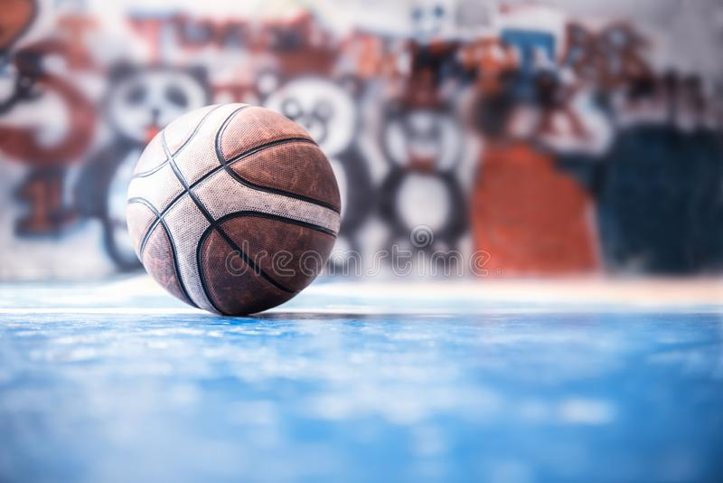 Old ball on the basketball court. Indoor sport in stadium. For exercise and healthy royalty free stock photo