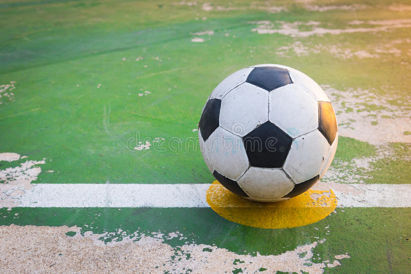 Old ball at kick off point in court. Old football at kick off point in court stock photo