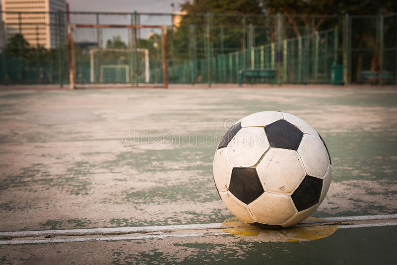 Old ball at kick off point in court. Old football at kick off point in court stock image
