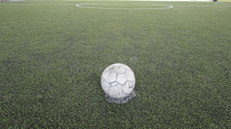 Old ball on new ground. At penalty kick spot royalty free stock photography