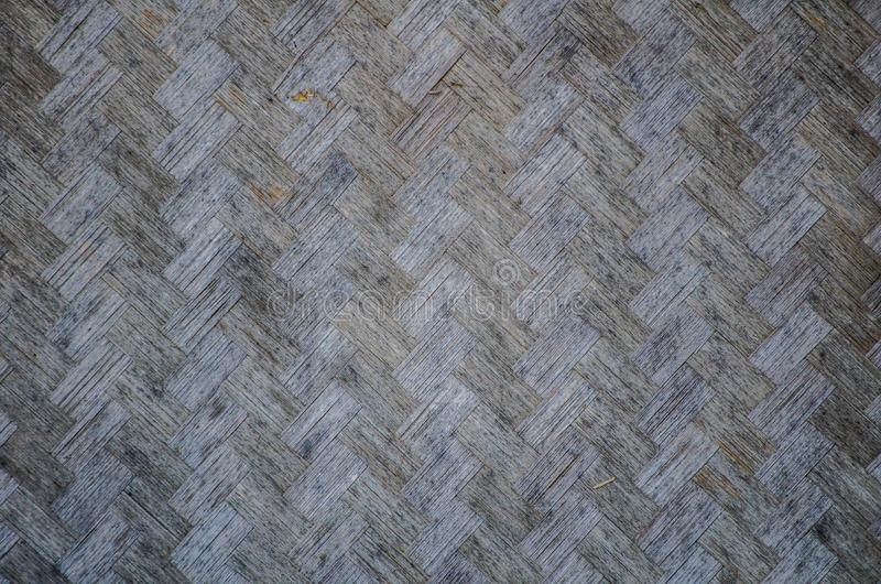 Old bamboo in basket-weave surface pattern for Asian house wall in close up. stock image