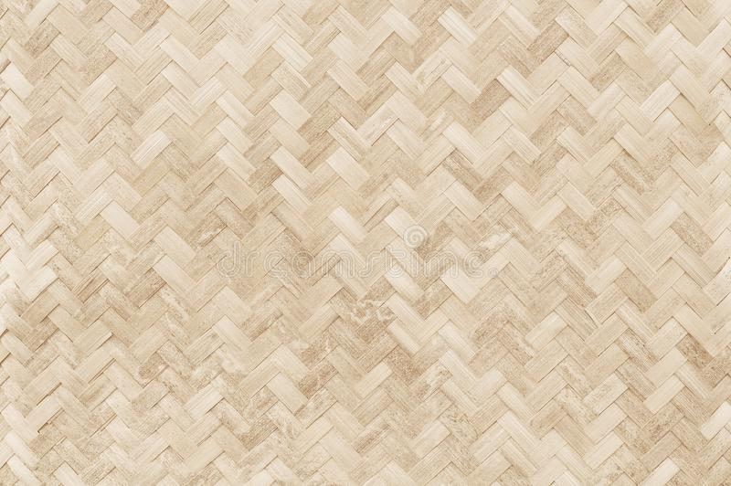 Old bamboo weaving pattern, woven rattan mat texture for background and design art work. stock photos