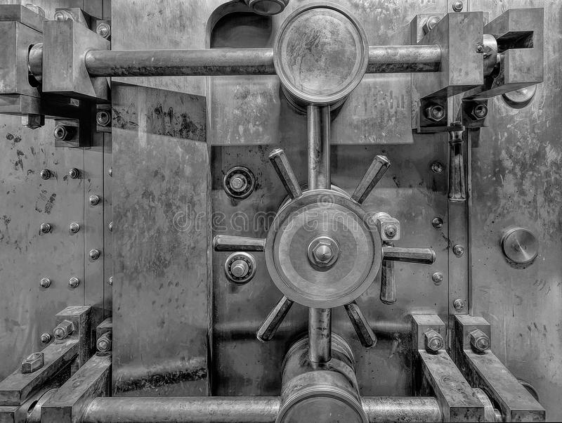 Old Bank Vault Black and White Closeup. Old Bank Vault in Basement of Historic Building in Black and White Grunge Texture Closeup royalty free stock images