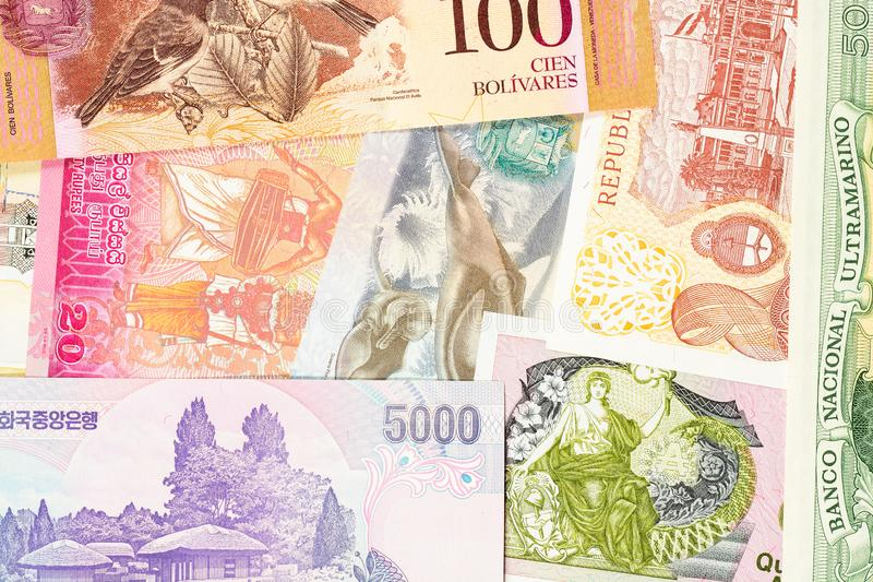 Old banknotes from different exotic countries. Colorful paper money background. Close-up macro royalty free stock photos