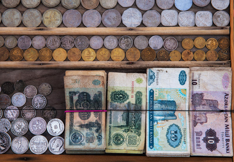 Old banknotes and coins stock photos