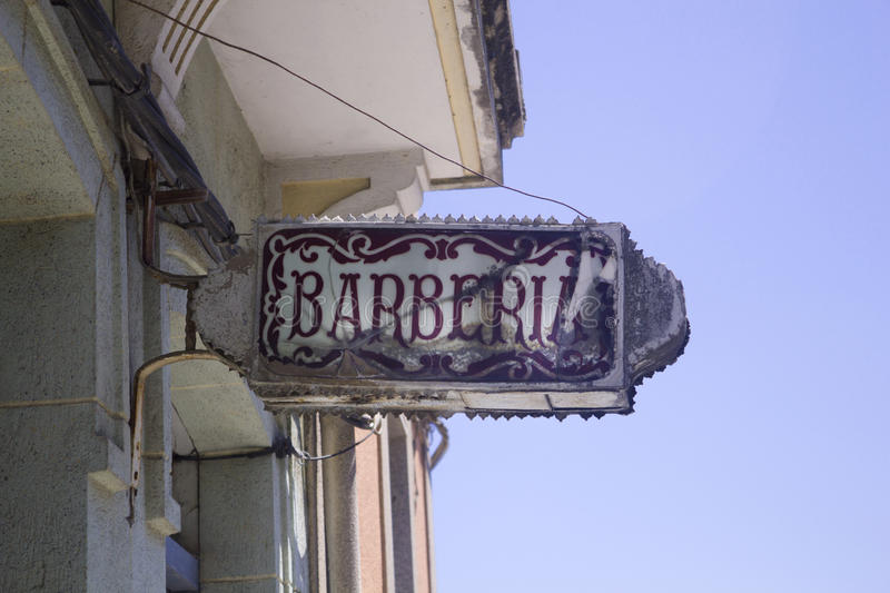 Old Barbershop sign. Spanish Old Barbershop sign in Galicia, nord of Spain royalty free stock photography
