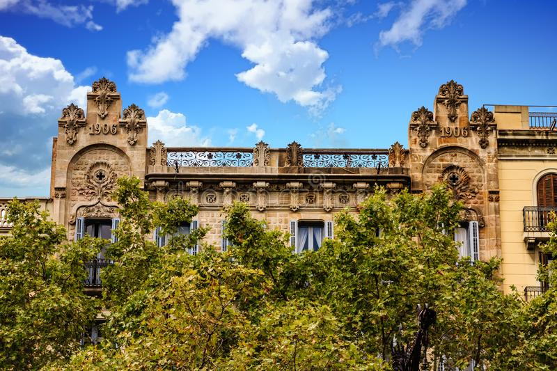Old Barcelona Building from 1906. Behind trees stock photography