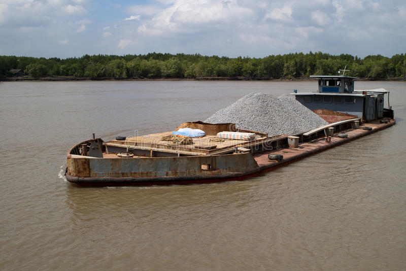 Old barge. Old and rusty barge on Saigon river Vietnam royalty free stock photography