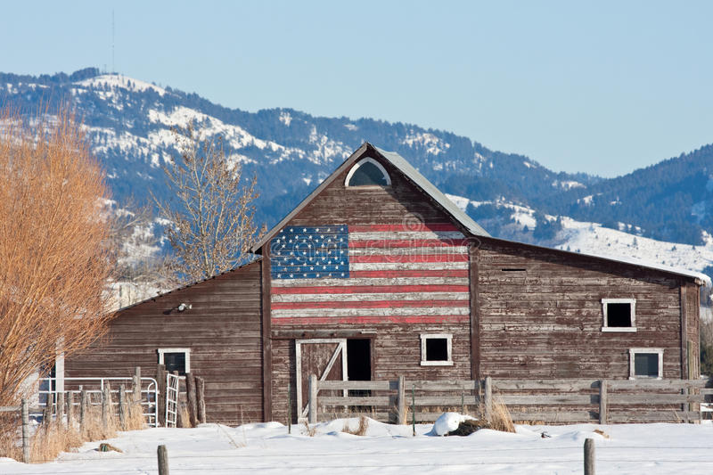 Old Barn with American Flag. An Old Weathered Barn with an American Flag Painted on it set in the Mountains royalty free stock photos