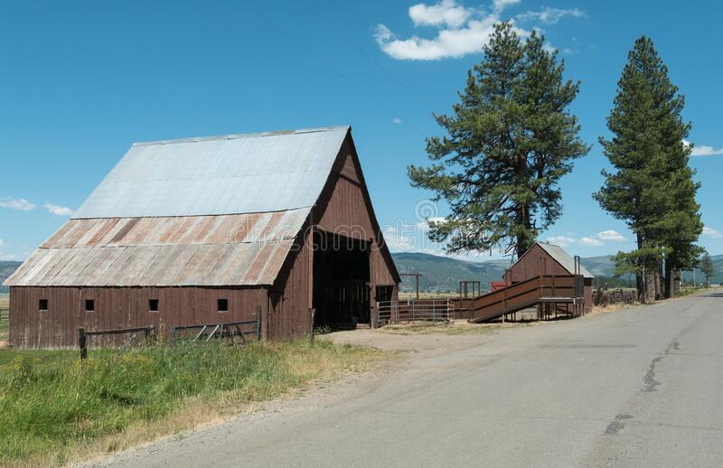 Old barn and cattle loader royalty free stock photos