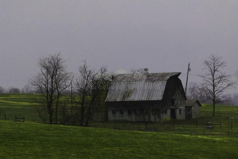 Old barn in the country falling apart stock photography