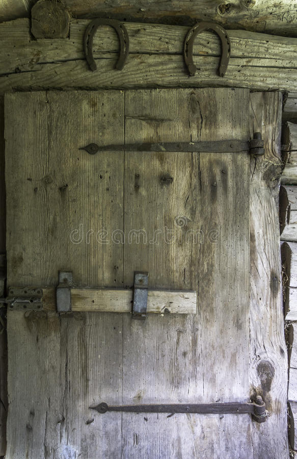 Old barn door. Made of weathered wood planks royalty free stock images