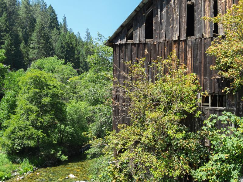 Old barn on the Downie River royalty free stock photo