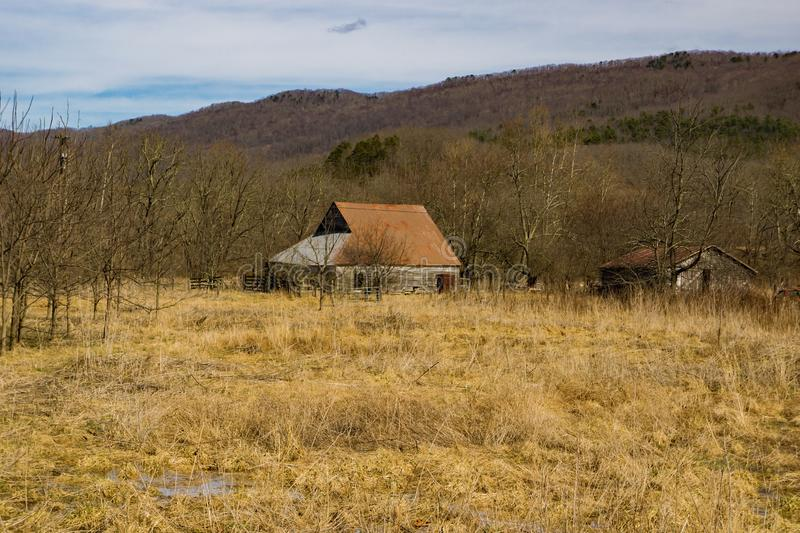 Rustic Old Barn in a Field. An old barn located in a field in Highland County, Virginia, USA stock photo