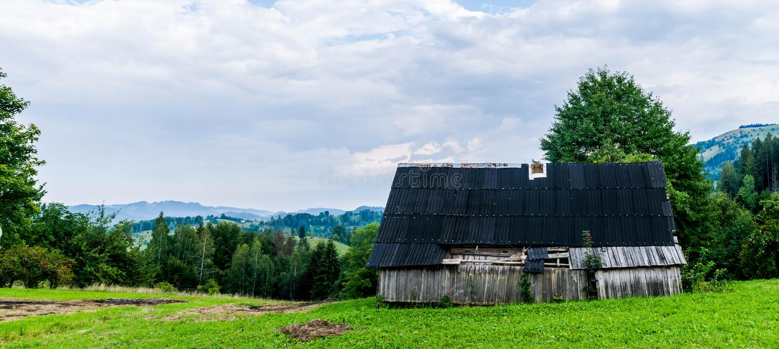 Old barn in the mountains stock photo