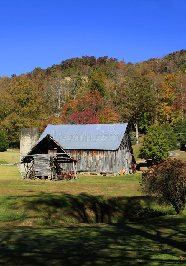 Old barn near Hendersonville NC. Old barn and fall colors near Hendersonville NC royalty free stock photography
