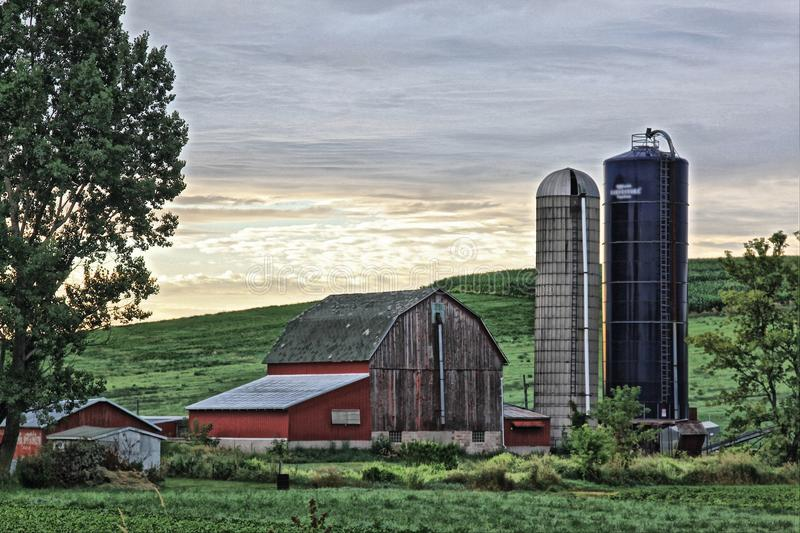 Old barn with out buildings and silos stock photography