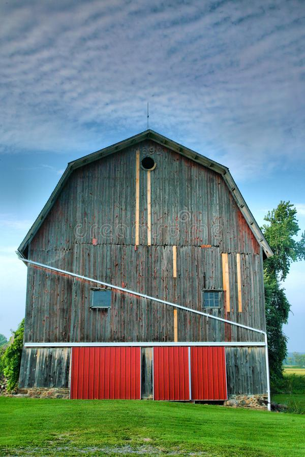 Old Barn With Red Doors royalty free stock photo