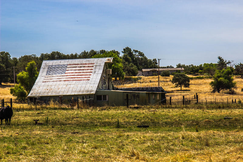 Old Barn & Sheds With American Flag On Roof stock image