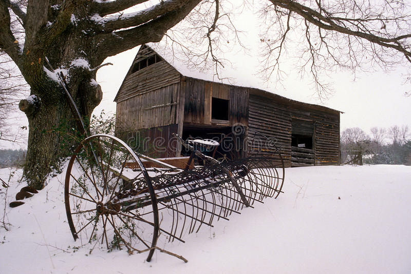 Old barn in the snow royalty free stock photos