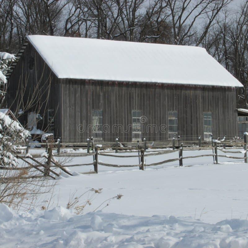 Old barn in snow stock photos