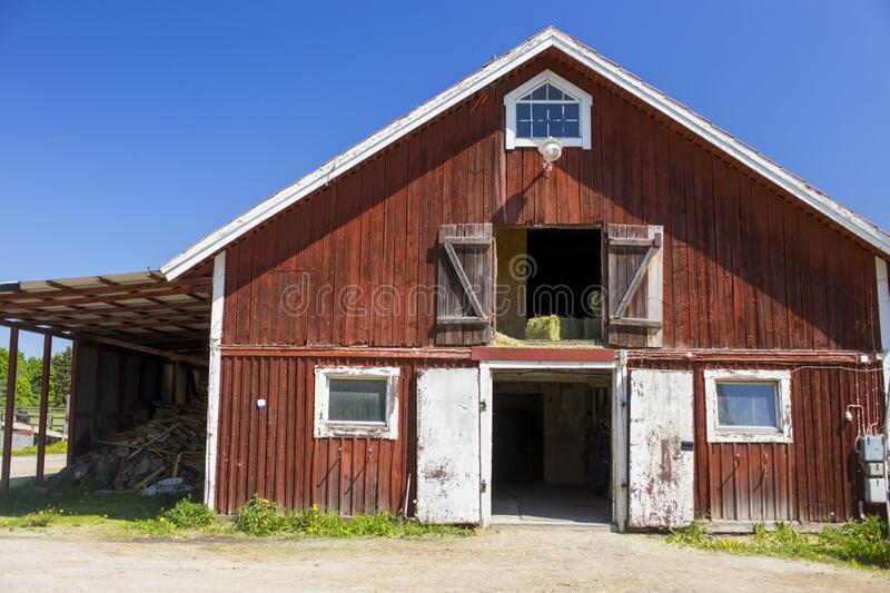 Old barn with red wood siding stock photography