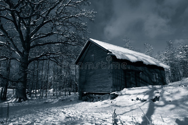 Old barn in winter stock image