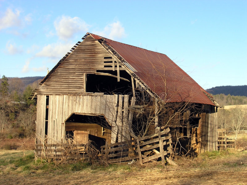 Old barn on a winter afternoon stock image