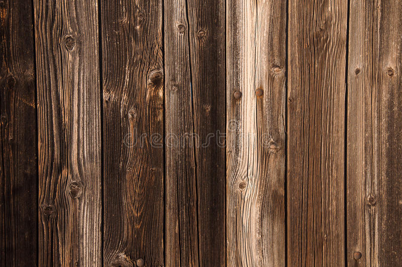 Old Barn Wood Floor Background Texture. Natural brown barn wood floor / wall texture background pattern. Wood planks / boards are very old with a beautiful