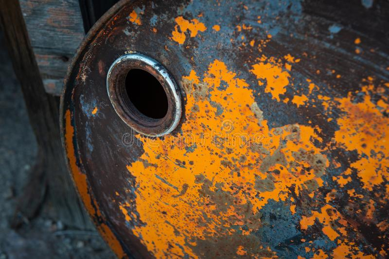 Old rusty oil barrel with orange paint royalty free stock photo
