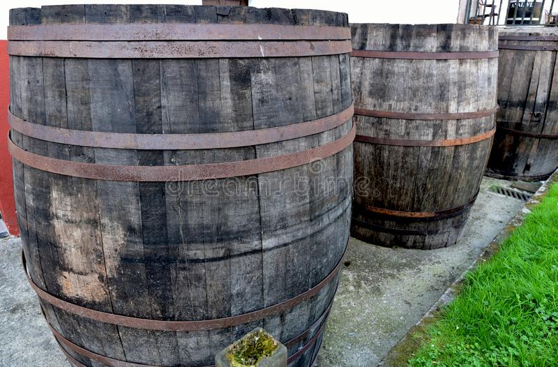Old barrels of cider in the street. Old barrels of cider factory in the street, Asturias, Spain royalty free stock photography