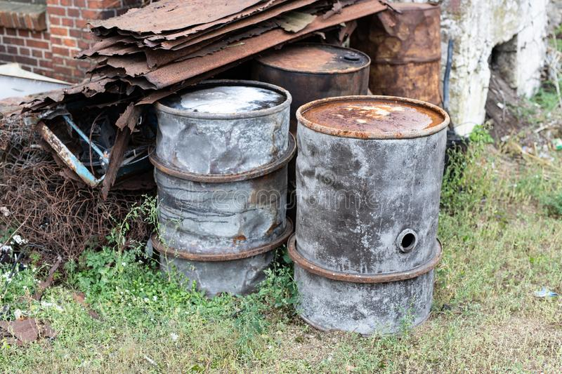 Old barrels for diesel. Metal containers for oil standing on the. Scrap yard. Season of the autumn royalty free stock images