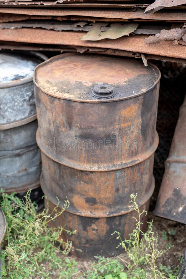 Old barrels for diesel. Metal containers for oil standing on the. Scrap yard. Season of the autumn royalty free stock photo