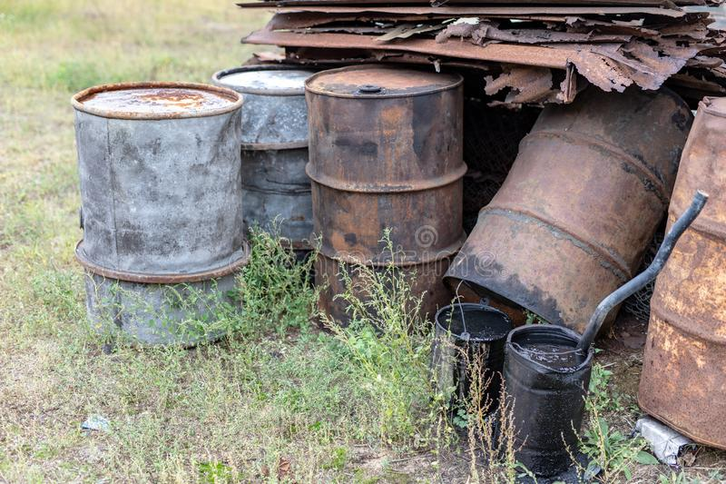 Old barrels for diesel. Metal containers for oil standing on the. Scrap yard. Season of the autumn royalty free stock photos