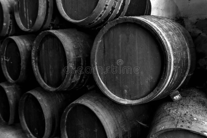 Old barrels for whiskey in black. And white royalty free stock photography