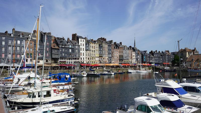 The old basin of Honfleur. France. On the Quai Sainte-Catherine, a whole series of tall houses pressed against each other, of different sizes, present this stock photos