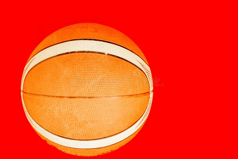 A blurry basket ball isolated with a blurry red background stock photo