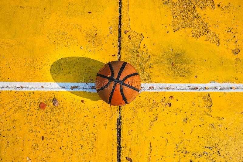 Old basketball in the basketball court. royalty free stock photography