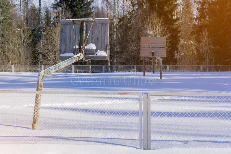 The old basketball court in the winter in the snow royalty free stock images