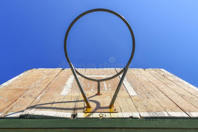 Old basketball hoop with a background of blue skies. Old basketball backboard. Outdoor sport equipment stock photos