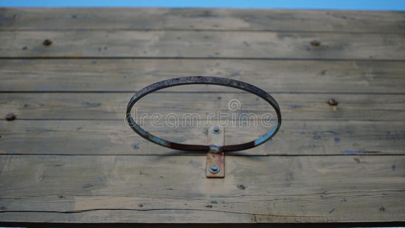 Old basketball hoop on wood backboard background stock images