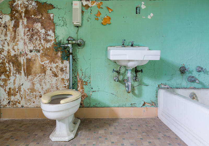 Old bathroom in need of renovation stock image