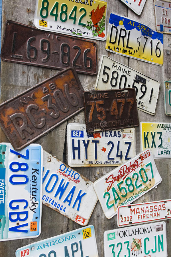 Old and battered car registration plates royalty free stock photos