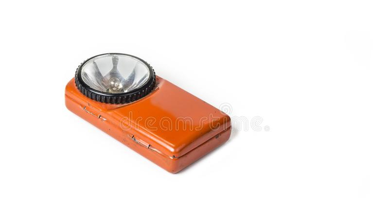 Old battery flashlight on the white background. royalty free stock photos