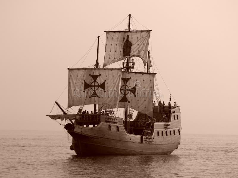 Old battle ship at sea stock photos