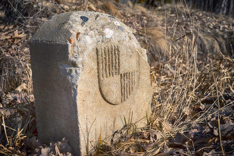 Old Bavarian border stone landmark in the meadow royalty free stock images