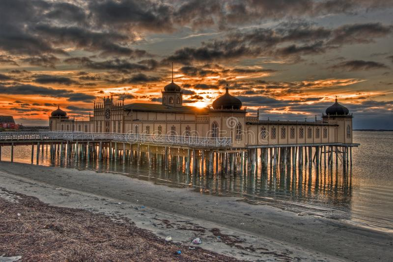 Old beach building in sunset from Sweden in HDR. Varberg city Cold bath house stands on stilts in the sea in the Kattegat Sea, off the west coast of Sweden. The