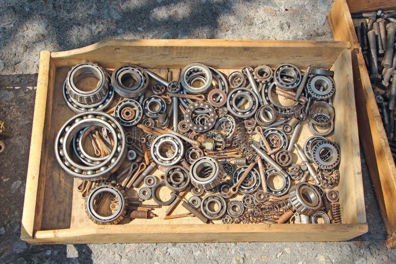 Old bearings. Rusty bearings, grey color, old screws, pile of old screws, tools elements, steel details, repair details, old rusty, texture, industry, workshop royalty free stock image